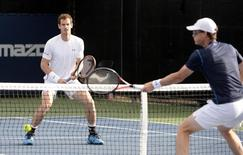 Aug 13, 2015; Montreal, Quebec, Canada; Andy Murray (left) faces brother Jamie Murray at the net during their doubles match during the Rogers Cup tennis tournament at Uniprix Stadium.   Eric Bolte-USA TODAY Sports