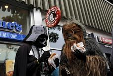 People wearing Star Wars-themed costumes eat pretzels in San Francisco, California July 21, 2015. REUTERS/Robert Galbraith