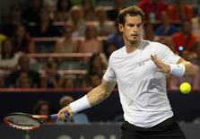 Aug 15, 2015; Montreal, Quebec, Canada; Andy Murray of Great Britain hits a shot against Kei Nishikori of Japan (not pictured) during the Rogers Cup tennis tournament. Mandatory Credit: Jean-Yves Ahern-USA TODAY Sports