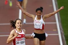 Asli Cakir-Alptekin of Turkey (L) crosses the finish line ahead of compatriot Gamze Bulut to win the women's 1500 metres final at the European Athletics Championships in Helsinki July 1, 2012. REUTERS/Laszlo Balogh