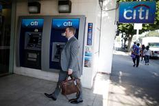 A man walks past a Citibank ATM in Los Angeles, California, March 10, 2015. REUTERS/Lucy Nicholson