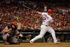 Aug 17, 2015; St. Louis, MO, USA; St. Louis Cardinals first baseman Mark Reynolds (12) drives in the game winning run on a fielders choice off of San Francisco Giants relief pitcher Hunter Strickland (not pictured) during the eighth inning at Busch Stadium. The Cardinals defeated the Giants 2-1. Mandatory Credit: Jeff Curry-USA TODAY Sports