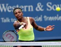 Aug 19, 2015; Cincinnati, OH, USA; Serena Williams (USA) charges the net to return a shot against Tsventana Pironkova (not pictured) on day five during the Western and Southern Open tennis tournament at Linder Family Tennis Center. Mandatory Credit: Aaron Doster-USA TODAY Sports