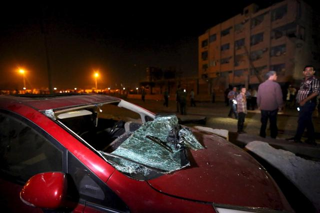 A damaged car is seen at the site of a bomb blast at a national security building in Shubra Al-Khaima on the outskirts of Cairo, Egypt August 20, 2015.    REUTERS/Mohamed Abd El Ghany