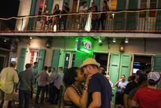 Revelers kiss on Bourbon Street, located in the French Quarter of New Orleans, Louisiana, in this July 11, 2015 file photo. REUTERS/Adrees Latif/Files