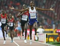 Mo Farah of Britain reacts after winning the men's 10000m event during the 15th IAAF World Championships at the National Stadium in Beijing, China August 22, 2015.     REUTERS/Lucy Nicholson