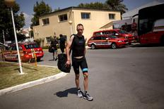 Team Sky rider Chris Froome of Britain arrives at his hotel after a team training session on the eve of La Vuelta cycling race, in Malaga, southern Spain, August 21, 2015. REUTERS/Jon Nazca