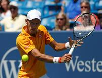 Aug 22, 2015; Cincinnati, OH, USA; Novak Djokovic (SRB) returns a shot against Alexandr Dolgopolov (not pictured) in the semifinals during the Western and Southern Open tennis tournament at the Linder Family Tennis Center. Mandatory Credit: Aaron Doster-USA TODAY Sports