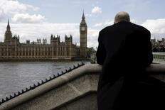 A man looks across the River Thames towards Big Ben and the Houses of Parliament in London, as Britain goes to the polls for a general election May 7, 2015. REUTERS/Kevin Coombs