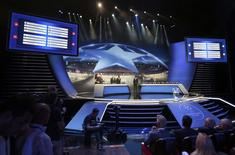 A general view of the screens shows the draw for the 2015/2016 UEFA Champions League Cup soccer competition at Monaco's Grimaldi Forum in Monte Carlo August 27, 2015.   REUTERS/Eric Gaillard