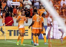 Aug 29, 2015; Houston, TX, USA; Houston Dynamo defender Raul Rodriguez (5) celebrates with forward Giles Barnes (10) after scoring a goal during the second half against the Vancouver Whitecaps FC at BBVA Compass Stadium. The Dynamo defeated the Whitecaps FC 2-0. Troy Taormina-USA TODAY Sports