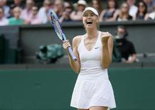 Maria Sharapova of Russia celebrates after winning her match against Coco Vandeweghe of the U.S.A. at the Wimbledon Tennis Championships in London, July 7, 2015. REUTERS/Stefan Wermuth