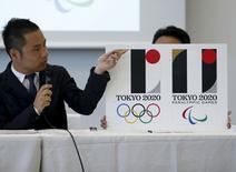 Kenjiro Sano, designer of Tokyo 2020 Olympic and Paralympic Games logos, explains about the designs during a news conference in Tokyo, Japan, August 5, 2015.  REUTERS/Yuya Shino