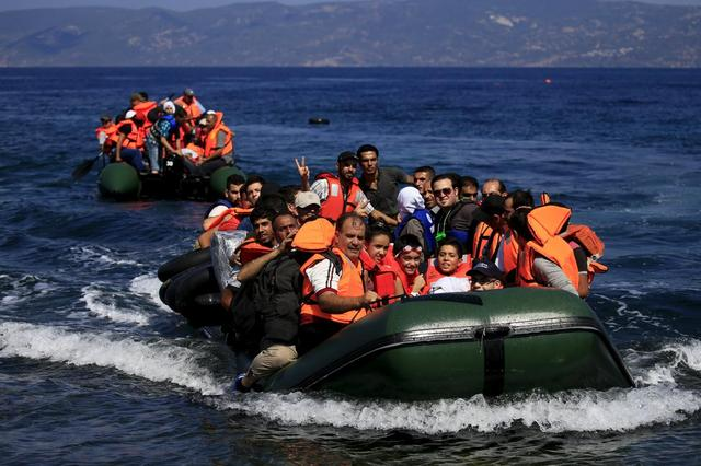 Syrian refugees arrive on two dinghies on the island of Lesbos, Greece August 22, 2015. REUTERS/Alkis Konstantinidis