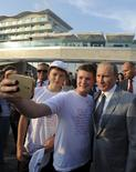 Russian President Vladimir Putin (R) poses for a selfie with students at the Sirius educational centre for gifted children in Sochi, Russia, September 1, 2015. REUTERS/Mikhail Klimentyev/RIA Novosti/Kremlin ATTENTION EDITORS - THIS IMAGE HAS BEEN SUPPLIED BY A THIRD PARTY. IT IS DISTRIBUTED, EXACTLY AS RECEIVED BY REUTERS, AS A SERVICE TO CLIENTS.