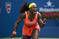 Serena Williams of the U.S. celebrates after defeating Kiki Bertens of the Netherlands during their second round match at the U.S. Open Championship tennis tournament in New York, September 2, 2015.       REUTERS/Lucas Jackson