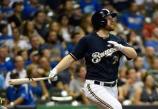 Sep 2, 2015; Milwaukee, WI, USA; Milwaukee Brewers first baseman Adam Lind (24) hits a solo home run in the fifth inning against the Pittsburgh Pirates at Miller Park. Mandatory Credit: Benny Sieu-USA TODAY Sports