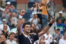 Novak Djokovic of Serbia celebrates after defeating Andreas Seppi of Italy in their third round match at the U.S. Open Championships tennis tournament in New York, September 4, 2015.  REUTERS/Adrees Latif