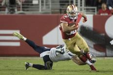 San Francisco 49ers running back Jarryd Hayne (38) runs with the football against San Diego Chargers defensive back Johnny Lowdermilk (42) during the third quarter in a preseason game at Levi's Stadium.  Kyle Terada-USA TODAY Sports