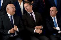 French Finance Minister Michel Sapin (L) and Eurogroup President Jeroen Dijsselbloem (C) and Spain's Economy Minister Luis de Guindos chat during a family picture at a European Union finance ministers meeting in Luxembourg, September 12, 2015. REUTERS/Eric Vidal