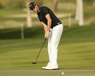 Thomas Pieters of Belgium putts on 16th green during the Abu Dhabi Golf championship January 17, 2015. REUTERS/Ahmed Jadallah