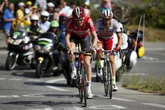 Lotto-Soudal rider Adam Hansen of Australia (L) and Katusha rider Marco Haller of Austria ride during the 201-km (124 miles) 16th stage of the 102nd Tour de France cycling race from Bourg-de-Peage to Gap, France, July 20, 2015.   REUTERS/Benoit Tessier