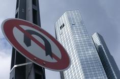 A 'No U-turn' traffic sign stands in front of Deutsche Bank headquarters in Frankfurt, Germany June 9, 2015. REUTERS/Ralph Orlowski