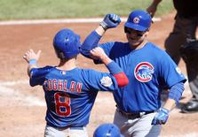 Sep 17, 2015; Pittsburgh, PA, USA; Chicago Cubs right fielder Chris Coghlan (8) and first baseman Anthony Rizzo (R) celebrate a two run home run by Rizzo against the Pittsburgh Pirates during the fifth inning at PNC Park. Mandatory Credit: Charles LeClaire-USA TODAY Sports