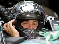 Mercedes Formula One driver Nico Rosberg of Germany sits in his car in the team garage at the Marina Bay street circuit ahead of the first practice session of the Singapore F1 Grand Prix September 18, 2015. REUTERS/Edgar Su