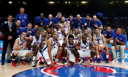 France's team players and staff members pose with their bronze medal after their EuroBasket 2015 third place game against Serbia at the Pierre Mauroy stadium in Villeneuve d'Ascq, near Lille, France, September 20, 2015. REUTERS/Benoit Tessier