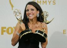 """Actress Julia Louis-Dreyfus poses backstage as she holds the awards for Outstanding Comedy Series and for Outstanding Lead Actress In A Comedy Series for her role in HBO's """"Veep"""" at the 67th Primetime Emmy Awards in Los Angeles, California September 20, 2015.   REUTERS/Mike Blake"""