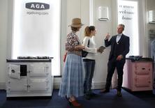 People discuss Aga ovens at the Aga Festival 2015 in London, Britain September 20, 2015.  REUTERS/Luke MacGregor
