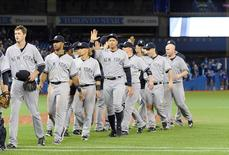 Sep 22, 2015; Toronto, Ontario, CAN; New York Yankees celebrate victory against Toronto Blue Jays in the tenth inning at Rogers Centre. Yankees beat Blue Jays 6 - 4. Mandatory Credit: Peter Llewellyn-USA TODAY Sports