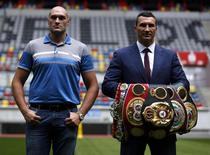 Ukrainian boxer Vladimir Klitschko and British boxer Tyson Fury (L) pose during a news conference in Duesseldorf, Germany July 21, 2015. REUTERS/Ina Fassbender