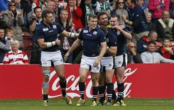 Rugby Union - Scotland v Japan - IRB Rugby World Cup 2015 Pool B - Kingsholm, Gloucester, England - 23/9/15 Mark Bennett celebrates with team mates after scoring the fourth try for Scotland Action Images via Reuters / Andrew Boyers Livepic