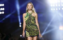 A model presents a creation from the Versace Spring/Summer 2016 collection during Milan Fashion Week. REUTERS/ Stefano Rellandini