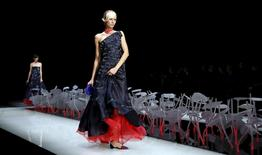 A model presents a creation from the Giorgio Armani Spring/Summer 2016 collection during Milan Fashion Week in Italy, September 28, 2015.  REUTERS/Alessandro Garofalo