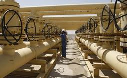 L'opérateur de gazoducs Williams Cos a accepté lundi d'être racheté par son concurrent Energy Transfer Equity pour 37,7 milliards de dollars (33,8 milliards d'euros) en numéraire et en titres, trois mois après avoir rejeté une offre de 53,1 milliards de dollars. /Photo d'archives/REUTERS/Atef Hassan