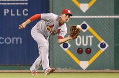 Sep 28, 2015; Pittsburgh, PA, USA; St. Louis Cardinals right fielder Stephen Piscotty (55) makes a catch against the Pittsburgh Pirates during the first inning at PNC Park. Mandatory Credit: Charles LeClaire-USA TODAY Sports
