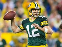 Sep 28, 2015; Green Bay, WI, USA; Green Bay Packers quarterback Aaron Rodgers (12) throws a pass during the fourth quarter against the Kansas City Chiefs at Lambeau Field.  Green Bay won 38-28.  Mandatory Credit: Jeff Hanisch-USA TODAY Sports