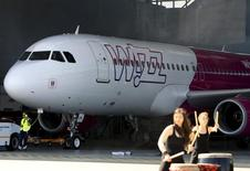 The new design of Wizz Air's aircraft is presented on the tarmac at Budapest Airport, Hungary, May 19, 2015.  REUTERS/Bernadett Szabo