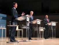 L-R Liberal leader Justin Trudeau, Conservative leader and Prime Minister Stephen Harper and New Democratic Party (NDP) leader Thomas Mulcair during the Munk leaders' debate on Canada's foreign policy in Toronto, Canada September 28, 2015. REUTERS/Fred Thornhill