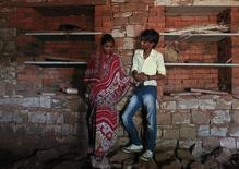Child bride Krishna, 13, stands with her husband Kishan Gopal, 15, inside a newly constructed room at her house in a village near Baran, located in the northwestern state of Rajasthan, July 17, 2012. REUTERS/Danish Siddiqui