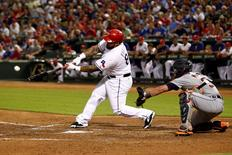 Sep 30, 2015; Arlington, TX, USA; Texas Rangers designated hitter Prince Fielder (84) hits a single to drive in a run in the third inning against the Detroit Tigers at Globe Life Park in Arlington.  Tim Heitman-USA TODAY Sports
