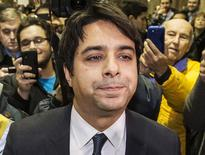 Canadian celebrity radio host Jian Ghomeshi leaves court after getting bail on multiple counts of sexual assault in Toronto, in this file photo taken November 26, 2014.  REUTERS/Mark Blinch/Files
