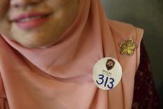 Majudi attends Halal Speed Dating, a matchmaking event, in Kuala Lumpur, Malaysia October 3, 2015. Halal Speed Dating, a new matchmaking event in Kuala Lumpur, is helping Malaysian Muslims find partners in a largely conservative society where courtship is frowned upon and marriages are often arranged.  REUTERS/Olivia Harris