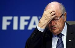 Re-elected FIFA President Sepp Blatter gestures during news conference after an extraordinary Executive Committee meeting in Zurich, Switzerland, in this May 30, 2015 file photo.  REUTERS/Arnd Wiegmann/Files