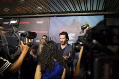 "Actor Keanu Reeves arrives for the Los Angeles Special Screening of ""Knock Knock"" in the Hollywood section of Los Angeles, California October 7, 2015.  REUTERS/David McNew"