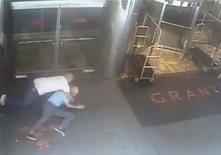 Ex-tennis star James Blake is shown tackled by a NYPD officer James Frascatore (L) in front of the Grand Hyatt hotel in New York on September 9, 2015 in this still image from a security camera video released on September 11, 2015. REUTERS/NYPD/Handout