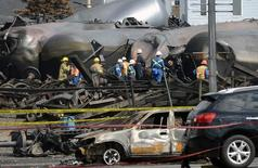 Workers work on the site of the train wreck in Lac Megantic, July 16, 2013.   REUTERS/Ryan Remiorz/Pool